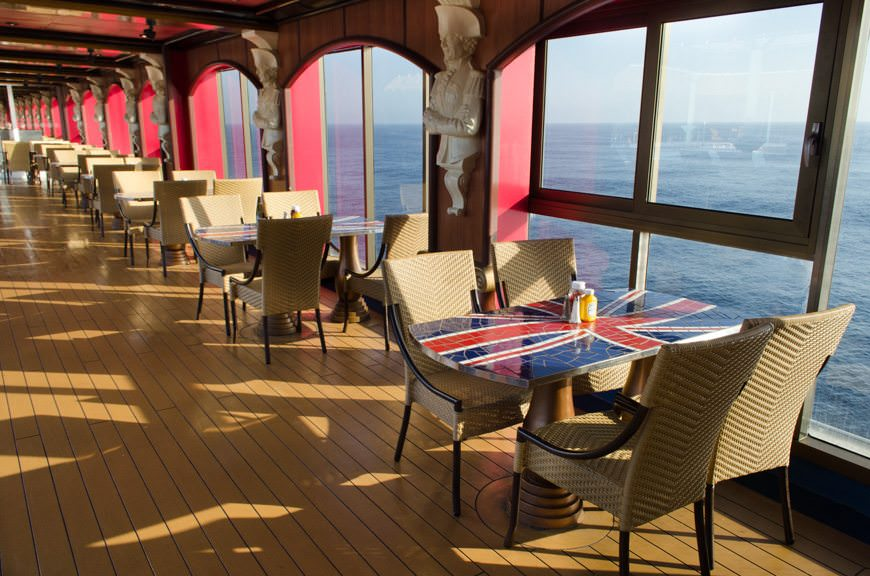 Good Morning! There's no better place to have breakfast and a cup of coffee than at the many tables that line the port and starboard sides of the Lido Deck, 9. Photo © 2015 Aaron Saunders