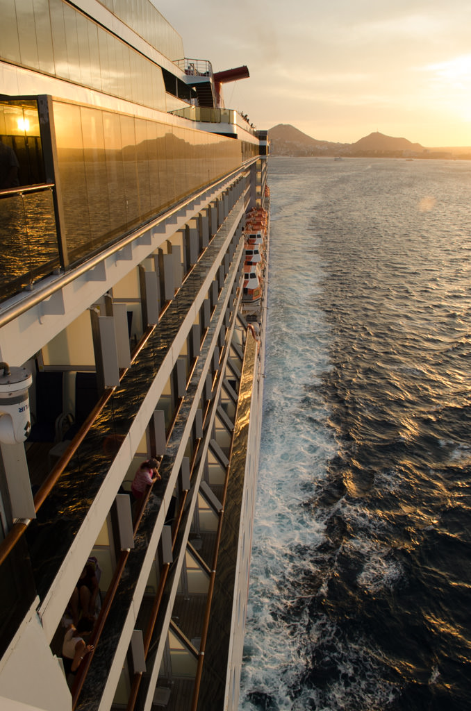 Carnival Miracle picks up speed and heads for Mazatlan, Mexico as the sun goes down. Photo © 2015 Aaron Saunders