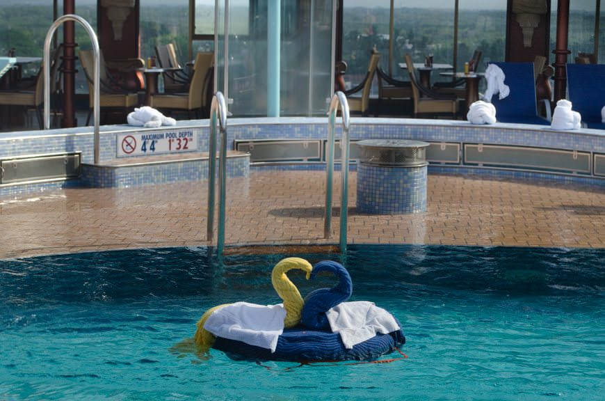 This morning, Carnival had their famous towel animals clustered around Carnival Miracle's midships pool on Deck 9. Photo © 2015 Aaron Saunders