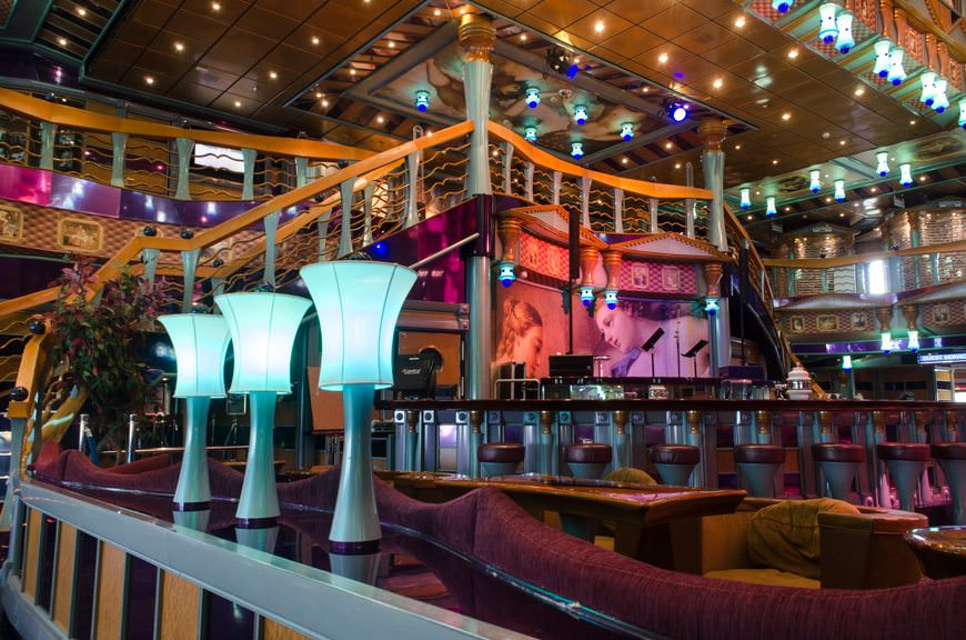 Carnival Miracle's Atrium Bar on a relaxing (and empty) morning onboard the ship. A staple of every Carnival ship, the Atrium Bar is a major social hub onboard. Photo © 2015 Aaron Saunders
