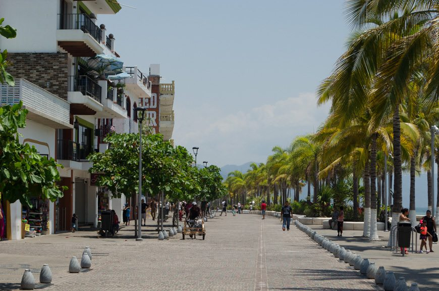 Strolling Puerto Vallarta's Malecon. The pedestrian road you see here used to be open to car traffic that zipped in and out. The entire Malecon is now serene. Photo © 2015 Aaron Saunders