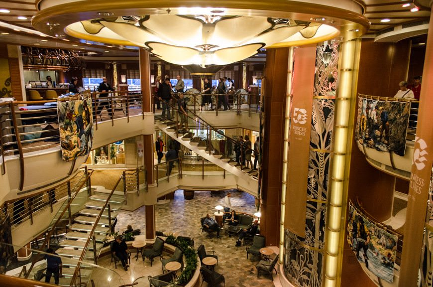 The glittering atrium aboard Star Princess, decked out in Alaska and Princess 50th Anniversary garb. Photo © 2015 Aaron Saunders