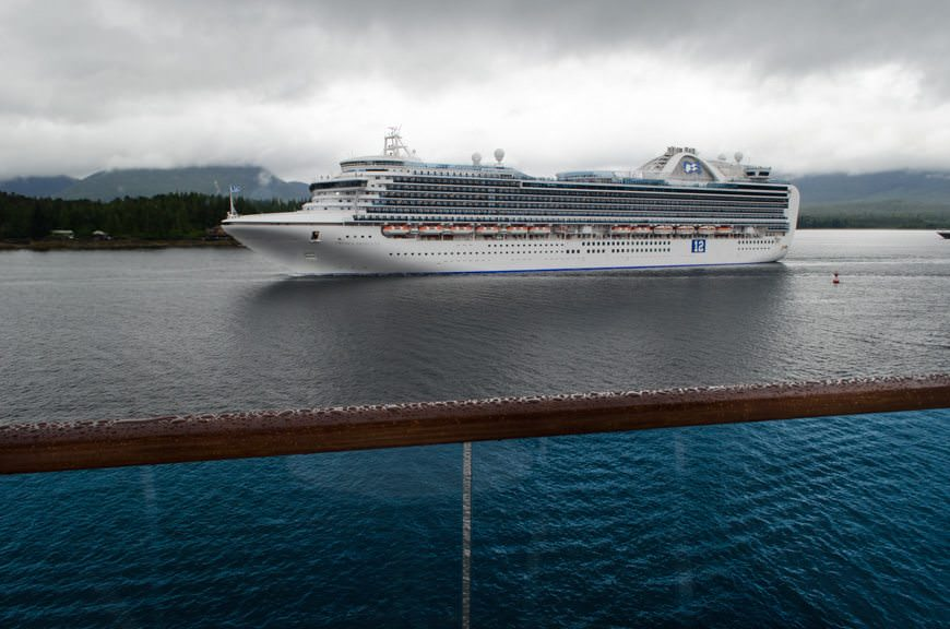 Princess Cruises' Crown Princess passes Star Princess on the afternoon of June 25, 2015 on a wet, rainy Ketchikan day. Photo © 2015 Aaron Saunders