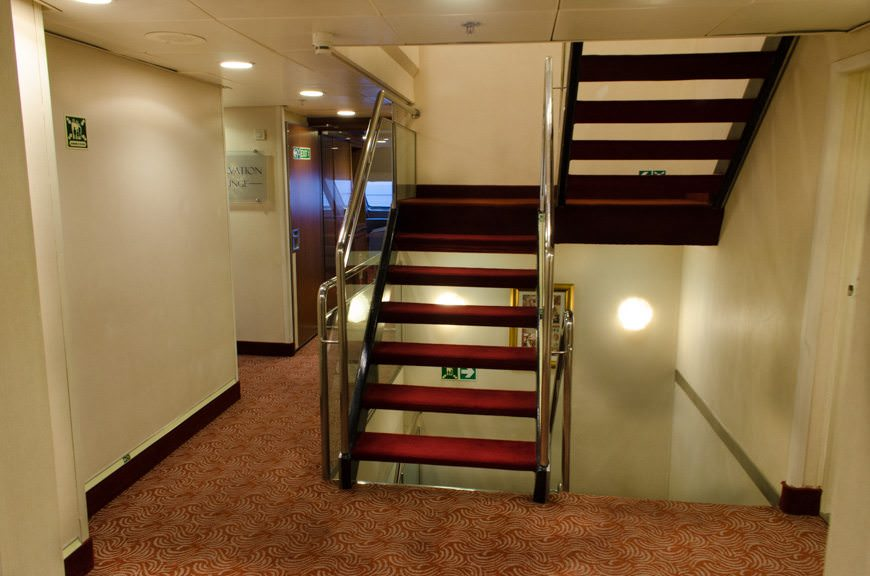 The forward staircase aboard Silver Explorer, Deck 6, facing forward. The Observation Lounge is accessible via the corridor on the left. Photo © 2015 Aaron Saunders