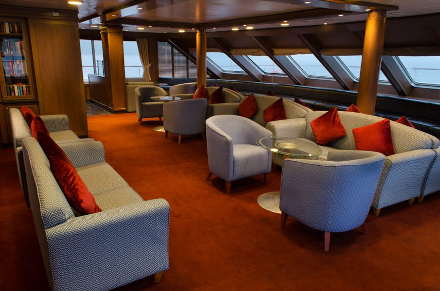 The Observation Lounge on Deck 6 forward provides a relaxing vantage point for admiring the passing scenery. Photo © 2015 Aaron Saunders