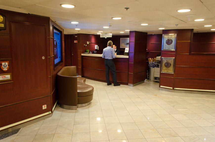 The Reception Area onboard Silver Explorer, Deck 3, facing starboard. Photo © 2015 Aaron Saunders
