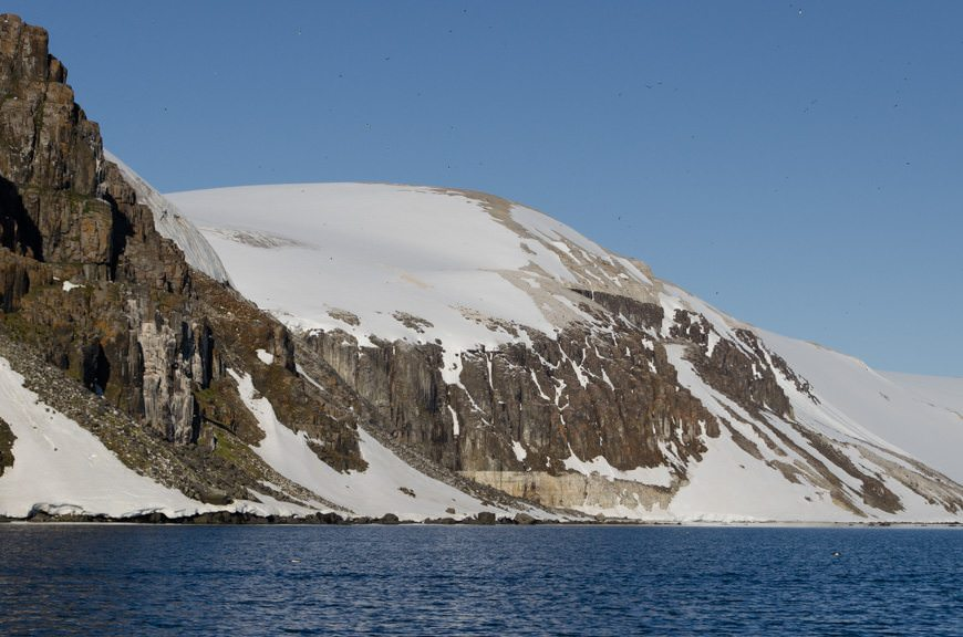 Check out this mountain. Can you see the different kinds of rock? The island is made up predominantly of basalt and limestone. Photo © 2015 Aaron Saunders