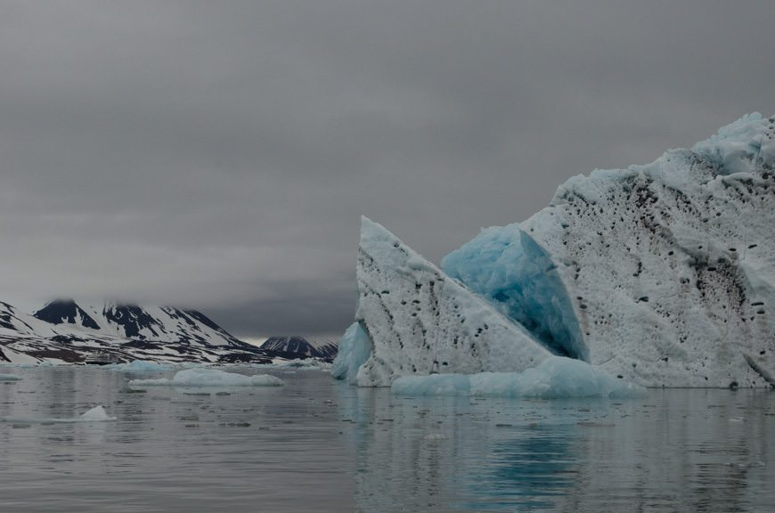Moody skies and cyan-blue ice recalls visions of Antarctica, blanketed by a different landscape. Photo © 2015 Aaron Saunders