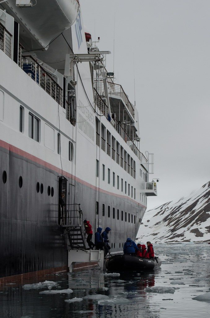 Guests disembark Silver Explorer in Burgerbukta, Svalbard for a Zodiac tour of the surrounding glaciers. Photo © 2015 Aaron Saunders