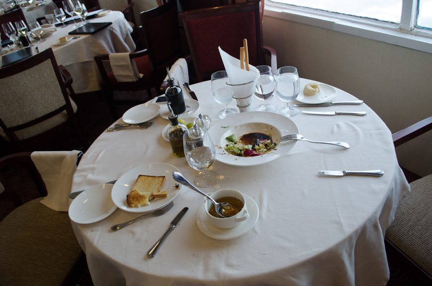 Guests jumped up so fast that food remained uneaten, and personal items were strewn about. Photo © 2015 Aaron Saunders