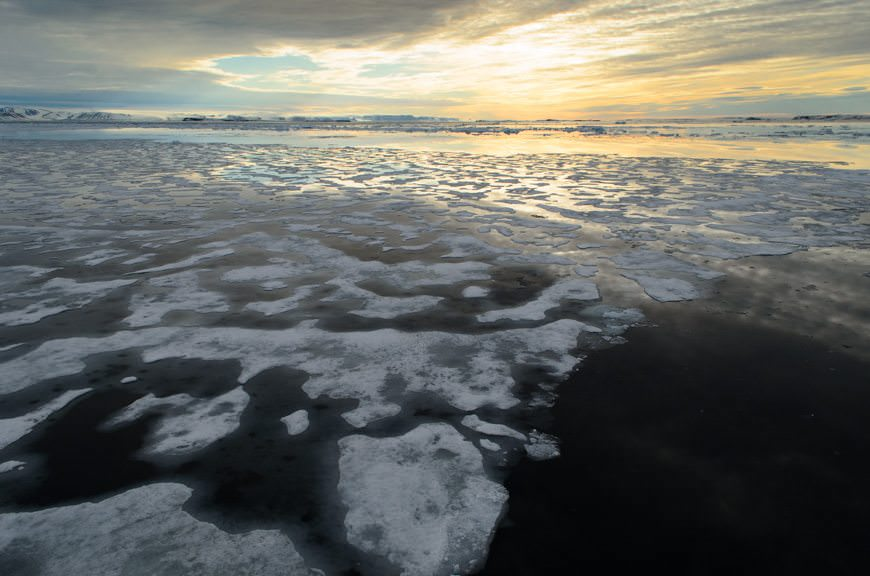 Sunset - or as close to it as we're ever going to get - in the pack ice in Arctic Svalbard. Photo © 2015 Aaron Saunders