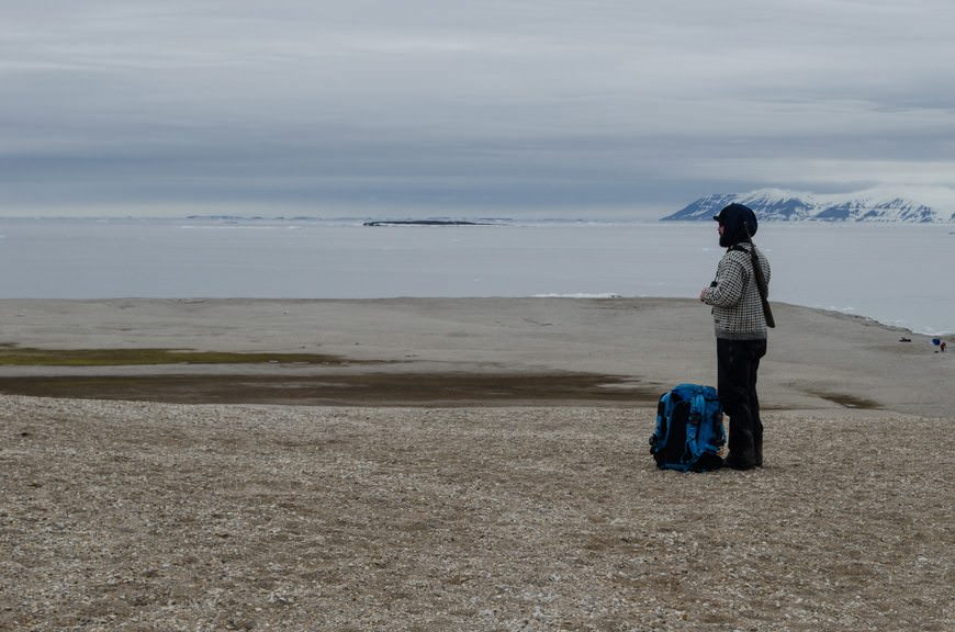 Polar Bear Guard and Expedition Team Member Chris on watch. Photo © 2015 Aaron Saunders