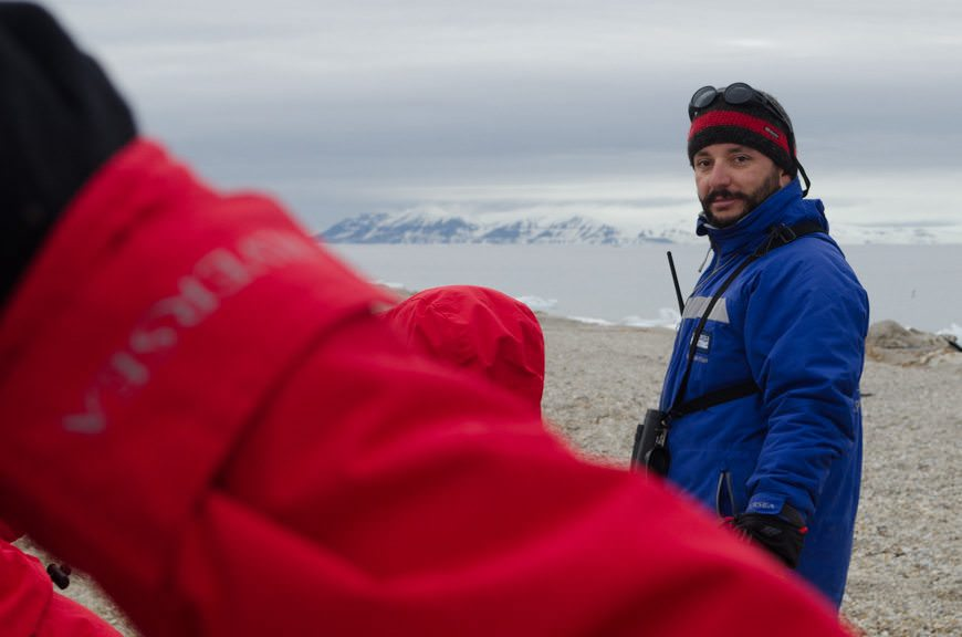 Expedition Leader Juan, right, overseeing zodiac operations at Torellneset this afternoon. Photo © 2015 Aaron Saunders