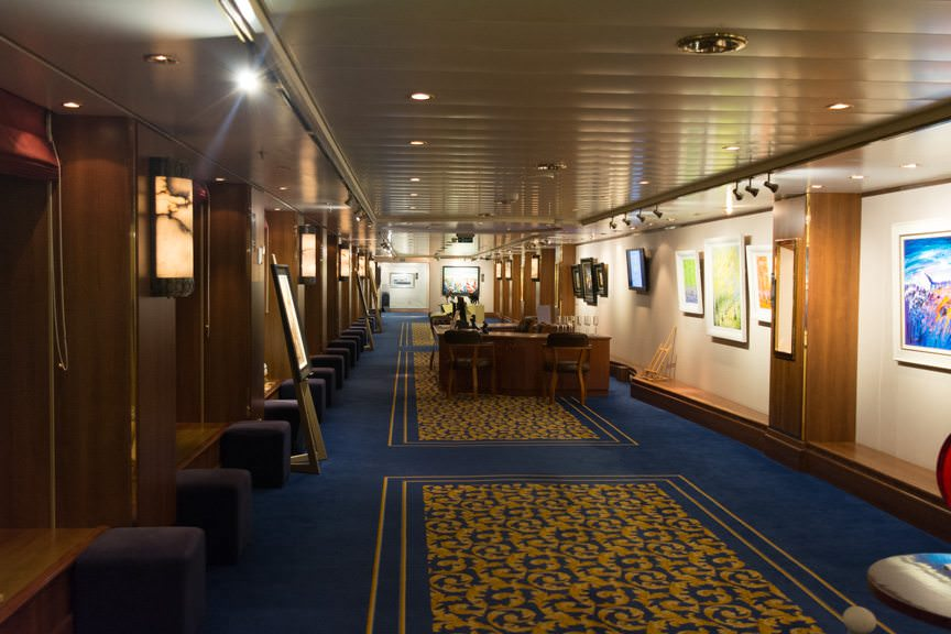 ...and the Images Photo Gallery on Deck 3L will be replaced with staterooms. Shown above is the Clarendon Art Gallery on Deck 3L, starboard side. It's been a nightmare to get a photo of the photo gallery, but it is identical to this corridor. Photo © 2015 Aaron Saunders