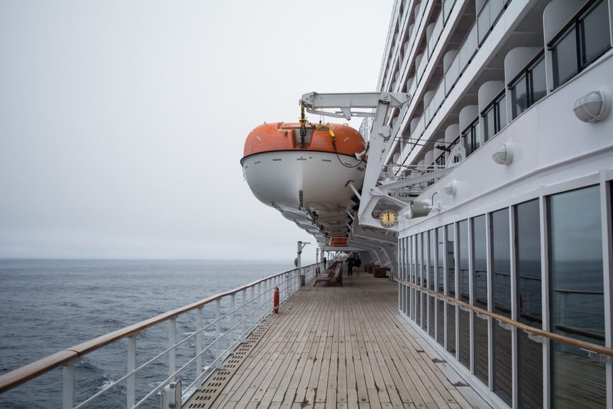 Sailing the High Seas aboard Queen Mary 2. Weather today was warmer, and conditions out on deck were superb despite the overcast skies. Photo © 2015 Aaron Saunders
