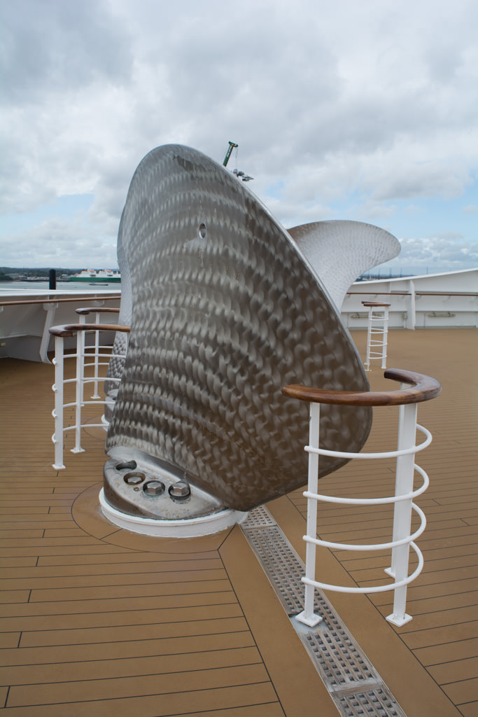 "This forward viewing area is home to ""The Commodore's Cufflinks"" - actually highly-polished spare propeller blades for QM2's four Rolls-Royce Mermaid podded propulsion units. Photo © 2015 Aaron Saunders"