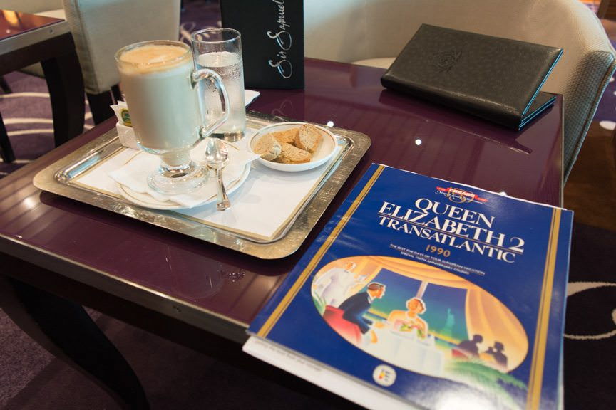 Some Reading Material: overlooking Cunard's 150th Anniversary Brochure for 1990 over coffee...Photo © 2015 Aaron Saunders