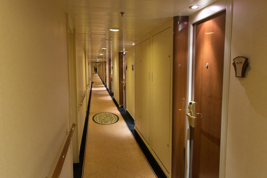 Queen Mary 2's passenger corridor, Deck 11. Incredibly, this was taken from just forward of the C Stairwell; over 150 feet of hallway are behind me! Photo © 2015 Aaron Saunders