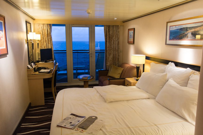 My stateroom at dusk, turndown service complete. I've opened the drapes, but normally they are shut with evening service. Photo © 2015 Aaron Saunders