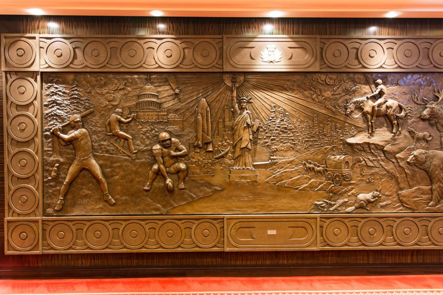 ....on the bas relief panels that line the Deck 3 corridor. Photo © 2015 Aaron Saunders