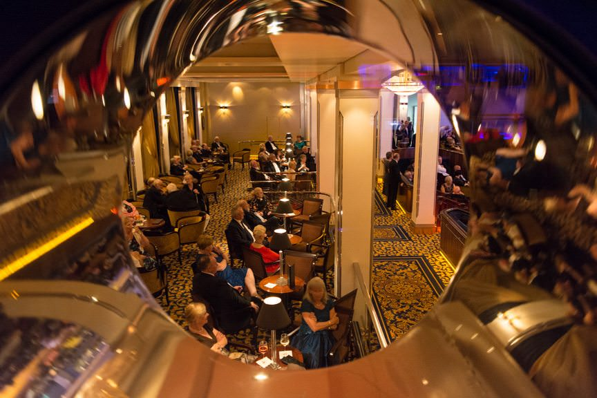 ...a more sedate party takes place in the Queen's Room. As seen from the porthole windows on the upper level of the G32 nightclub. Photo © 2015 Aaron Saunders