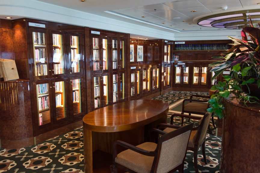 It is matched only by the 8,000-volume strong Library one deck below, on Deck 8 forward. It is the largest library at sea. A small wing of it is shown here. Photo © 2015 Aaron Saunders