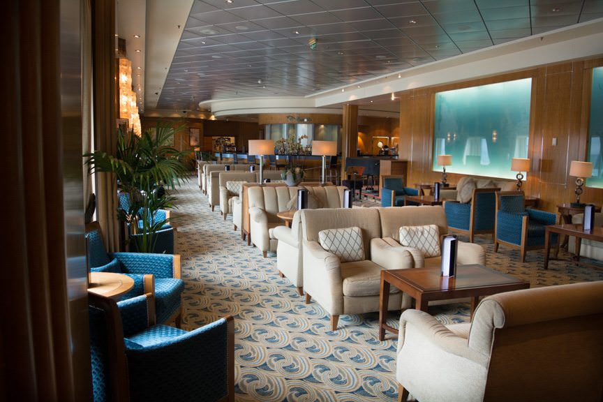 Immediately aft of the Champagne Bar is the Chart Room, one of the most popular lounges onboard. Photo © 2015 Aaron Saunders