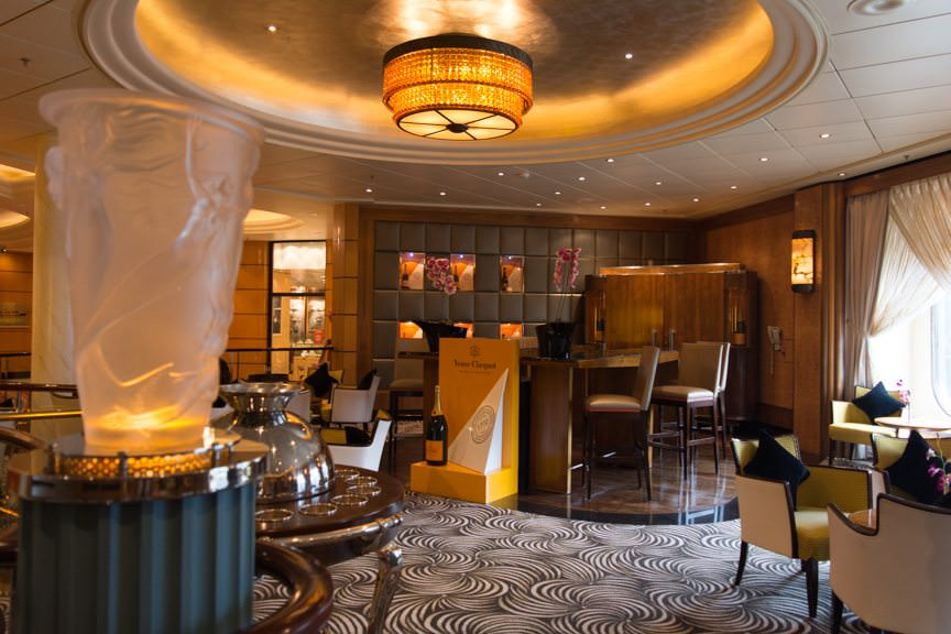 The Veuve Cliquot Champagne Bar on Deck 3 is adjacent to the embarkation area. It is one of the first public rooms you see as you embark. Photo © 2015 Aaron Saunders