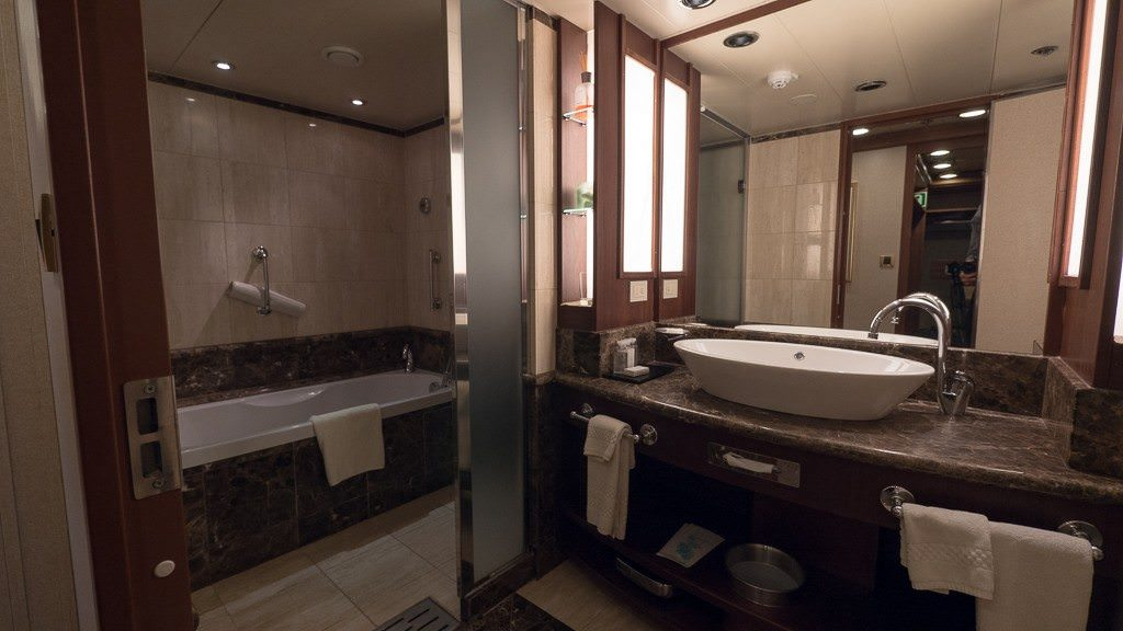 Suite 704 bathroom with tub and rainforest showerhead on Silver Explorer. ©2015 Ralph Grizzle