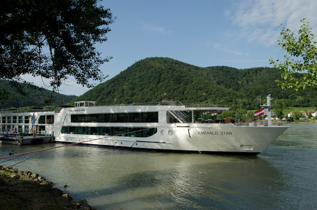 A river cruise along the Danube is a great choice for first-time cruisers. Shown here is Emerald Waterways' Emerald Star, docked in Durnstein, Austria. Photo © 2014 Aaron Saunders