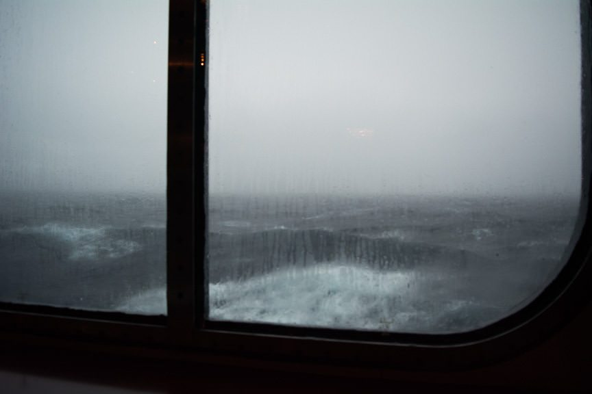 The view out the window next to me. The seas were angry, my friends! Photo © 2015 Aaron Saunders