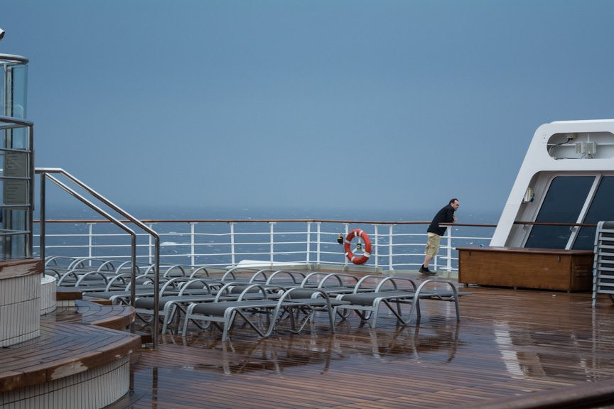 A few hearty souls venture out on Deck 8 aft following the heavy rains that lashed the ship for over an hour. Photo © 2015 Aaron Saunders
