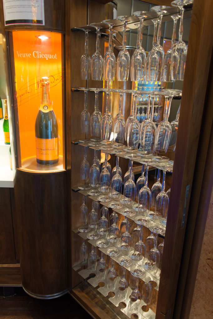 Crystal wine glasses hang suspended nearby. Photo © 2015 Aaron Saunders