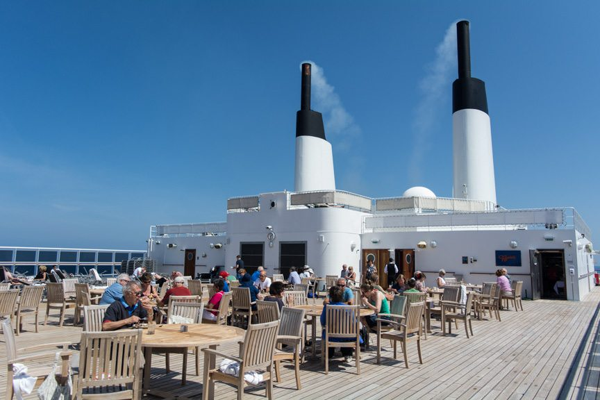 The Boardwalk Cafe on Deck 12 aft even opened up today. The two stacks are galley exhausts. Photo © 2015 Aaron Saunders