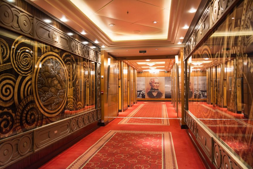 The Grand Corridor that runs down the centerline of the ship on Deck 3. Another identical corridor (with different artwork) is cleverly featured on Deck 2. Photo © 2015 Aaron Saunders