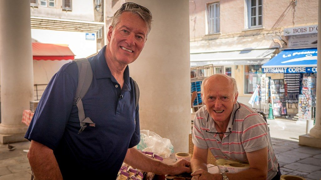 With the 'honey man' in Ile Rousse, Corsica. © 2015 Avid Travel Media Inc.