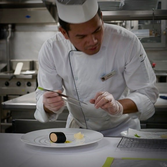 "Precision cooking and placement with ""tools of refinement"" such as tweezers instead of tongs. New concepts being brought to Seabourn by Thomas Keller. © 2015 Ralph Grizzle"