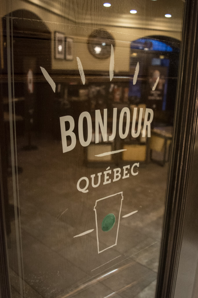 The Fairmont Chateau Frontenac has an on-site Starbucks with this whimsical welcome. Photo © 2015 Aaron Saunders