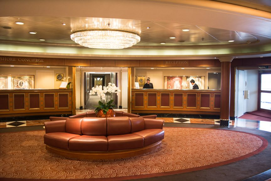 Reception and Shore Excursion desks are also located on Deck 5, midships. Photo © 2015 Aaron Saunders