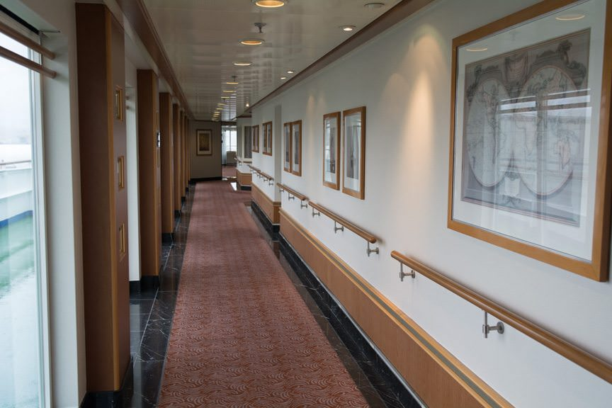 This attractive corridor on Deck 10 forward leads to...Photo © 2015 Aaron Saunders