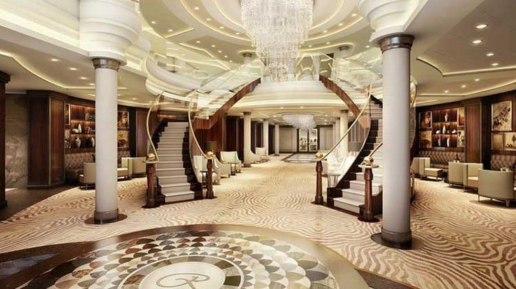The high standard of opulence set by the suites will carry through to the rest of the ship. Shown here is a rendering of the central lobby atrium. Rendering courtesy of Regent Seven Seas.