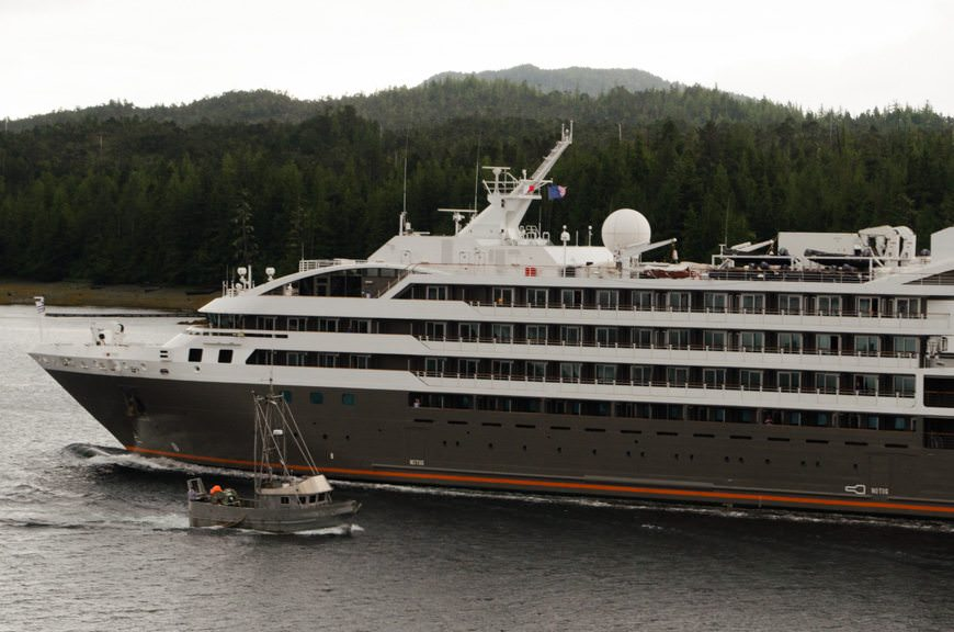 Ponant's L'Austral, sister to Le Soleal, passes a fishing trawler near Ketchikan, Alaska. Photo © 2015 Aaron Saunders