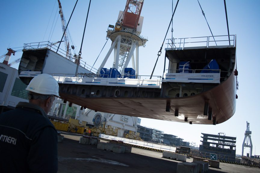 ...and lowered into position in the construction drydock. Photo © 2015 Aaron Saunders