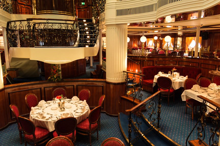 The gorgeous Clipper Dining Room is the main dining venue aboard Royal Clipper. Photo © 2015 Aaron Saunders