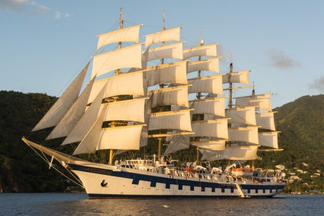 Star Clipper's Royal Clipper, illuminated at sunset in Soufriere, St. Lucia. Photo © 2015 Aaron Saunders