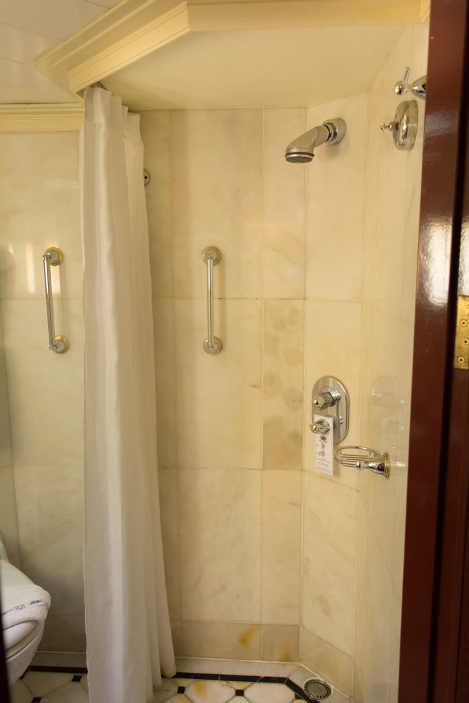 The bathroom is larger than you'd expect, and is clad in attractive marble. Word to the wise: the shower, shown here, doesn't keep the water inside. Expect your bathroom floor to get wet, but well-placed drains usually make short work of it. Photo © 2015 Aaron Saunders