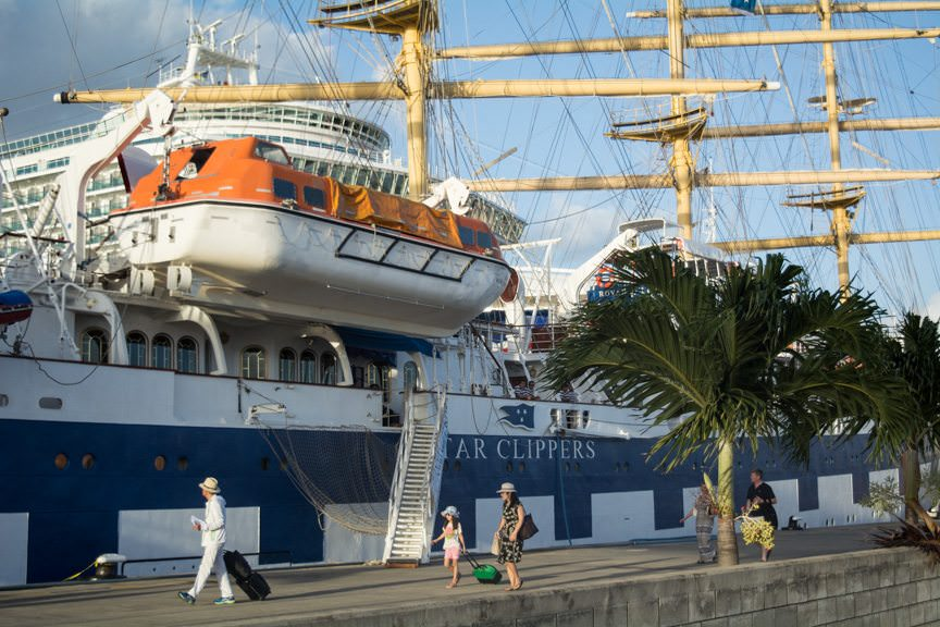 Guests casually embark Royal Clipper at her berth in the port of Bridgetown. There are no long lines, no massive check-in operations. Just check your name against the manifest, grab a cocktail, and welcome aboard! Photo © 2015 Aaron Saunders