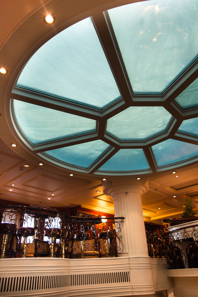 The gorgeous ceiling above the Piano Bar is actually the underside of the midships swimming pool. Photo © 2015 Aaron Saunders