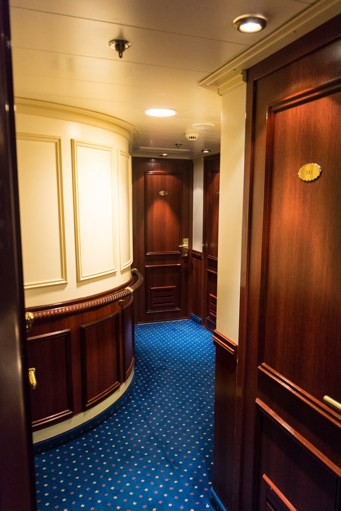 Guest corridors curve attractively as you near the midships area. Photo © 2015 Aaron Saunders