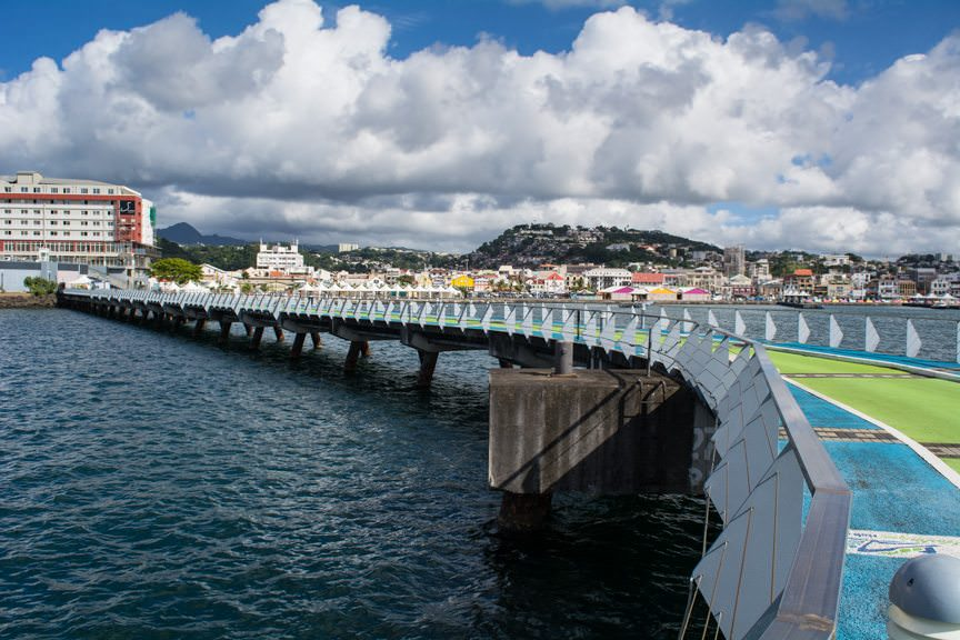 The first thing you'll notice is that a very colourful pier apron brings you into the heart of the city. Colour is a major part of Martinique's look and feel. Photo © 2015 Aaron Saunders
